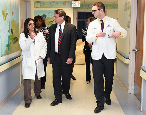Hurley Medical Center researcher Mona Hanna-Attisha and other hospital staff discuss Flint's water crisis with Sen. Gary Peters (D).
