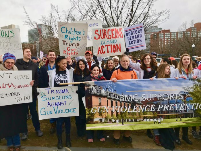 Tracy Dechert, left, and other members of the socially responsible surgery group at Boston Medical Center attend the 2018 March for our Lives in Boston.